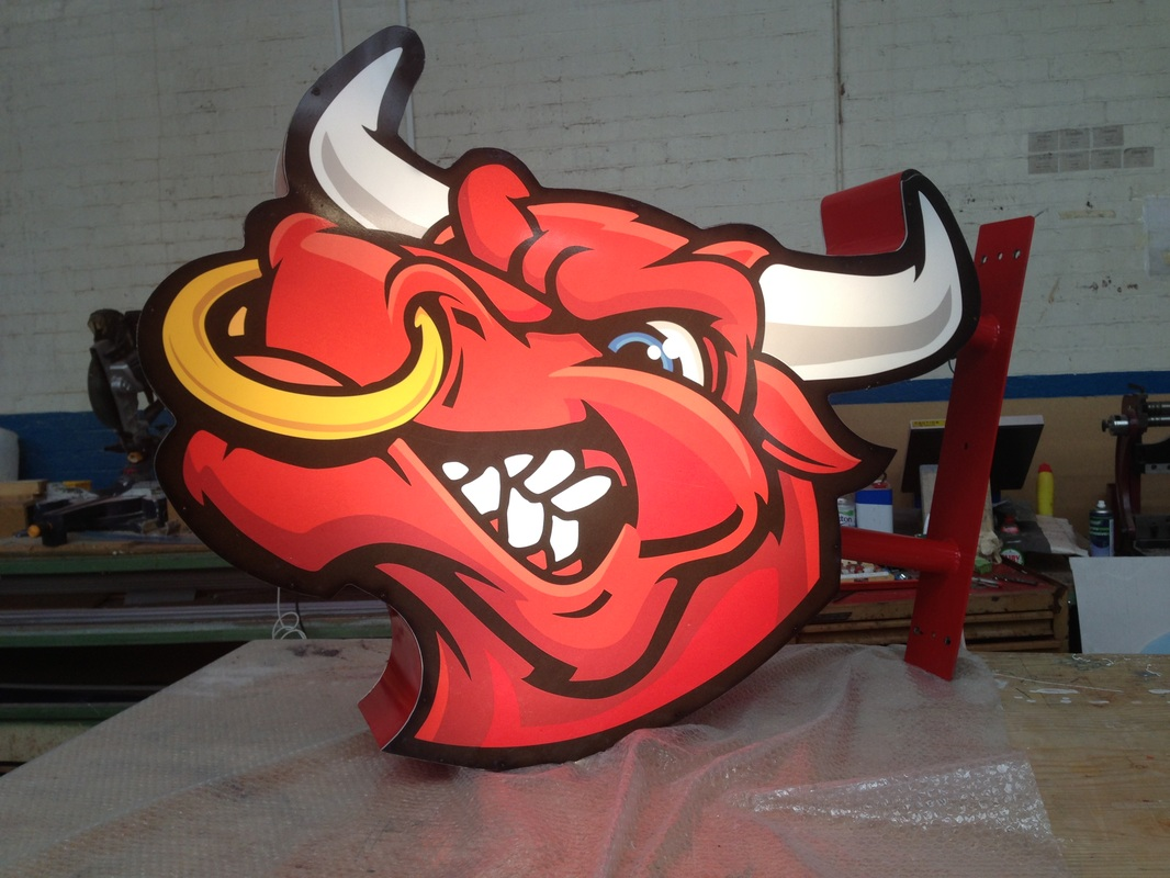 Bulls head protruding sign.